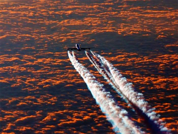 photo of planes in the clouds