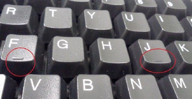 Raised fist with keyboard symbols