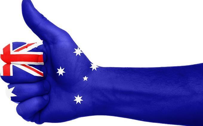 hand with australian flag