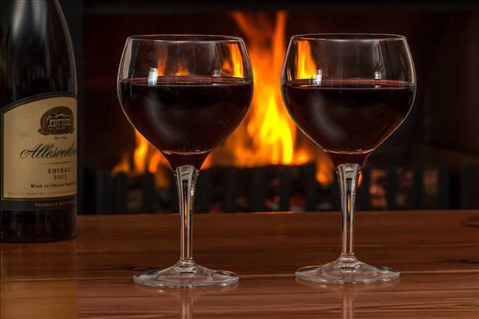 wine glasses by the fire