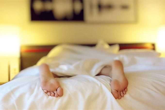 Feet peeking out of a blanket
