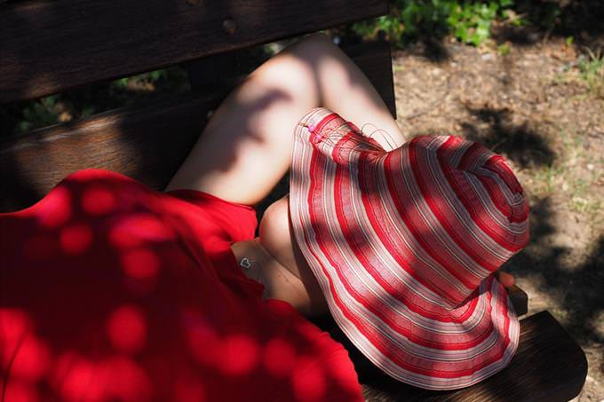 woman sleeping on park bench