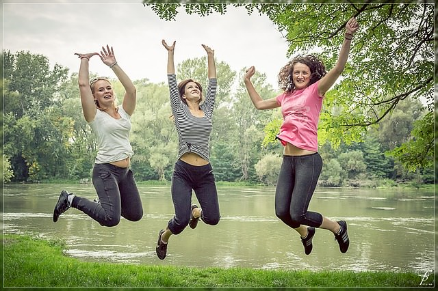 health benefits of peaches: women jumping in the air