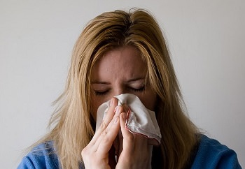woman wiping nose