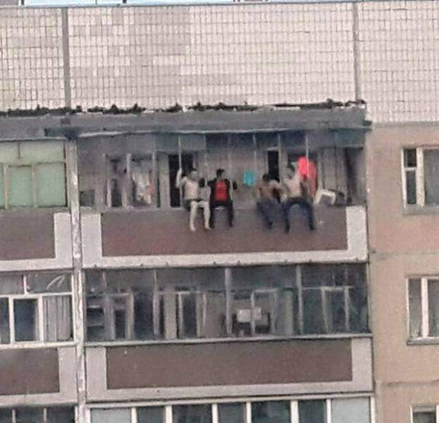 funny pictures of bad ideas, men sitting on railing of a building