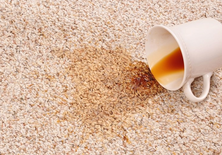 Different Coffee Removal Methods, White coffee mug on its side with spilled coffee on a carpet