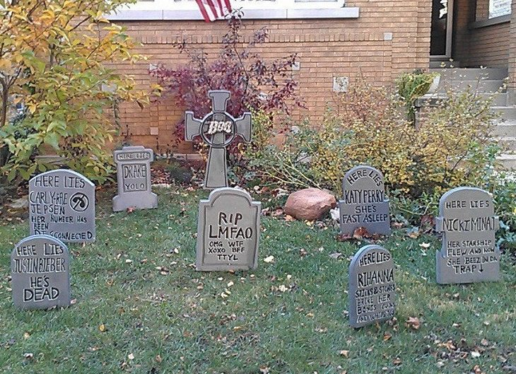 Most Incredible Halloween Decorations, series of false tombstones with the names of current pop stars like Justin Bieber