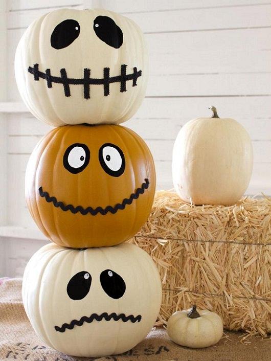 Most Incredible Halloween Decorations, white and orange jack-o-lanterns, semi-smiling