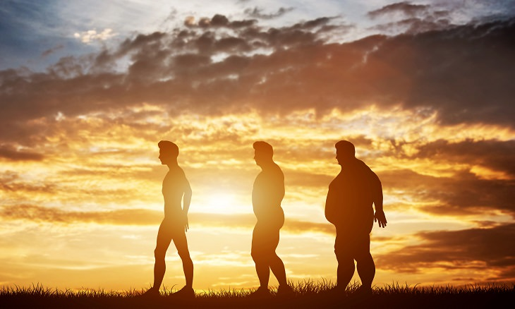 Exercising before food is beneficially to health. three men of different size and stature standing in a grassy place