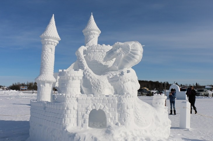 Snow Sculptures and Statues from Festival, snow sculpture of castle with a dragon climbing it