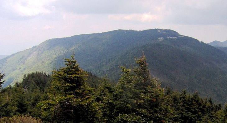 Beautiful sights and views of various mountains, peaks and wildlife in the blue ridge mountain range, Mount Mitchell, the Highest Peak of the Blue Ridge Mountain Range, as viewed from Mount Craig of the Black Mountain Range
