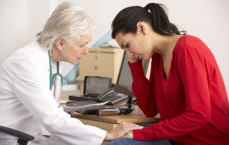 old female doctor giving bad news to female patient