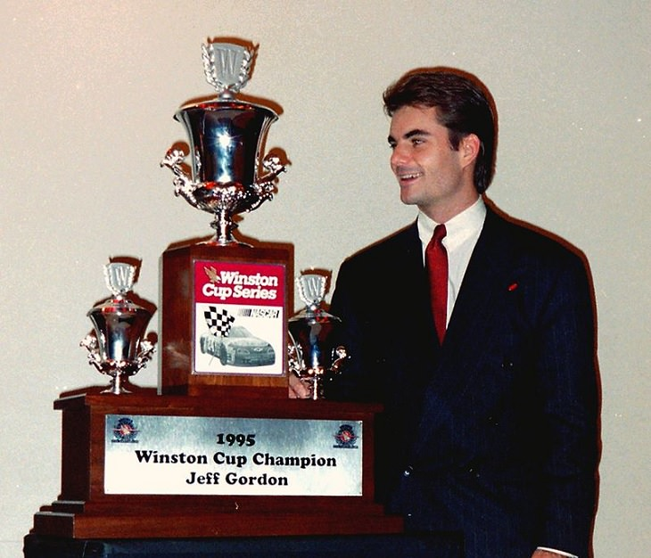 Top 19 NASCAR Race Drivers to Win Multiple Tracks, jeff gordon with 1995 winston cup champion trophy