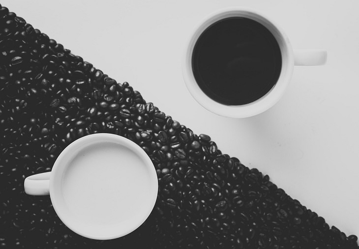 DIY homemade coffee creamer, large triangle with coffee beans and a cup of milk in the middle next to another white triangle with a cup of black coffee in the middle