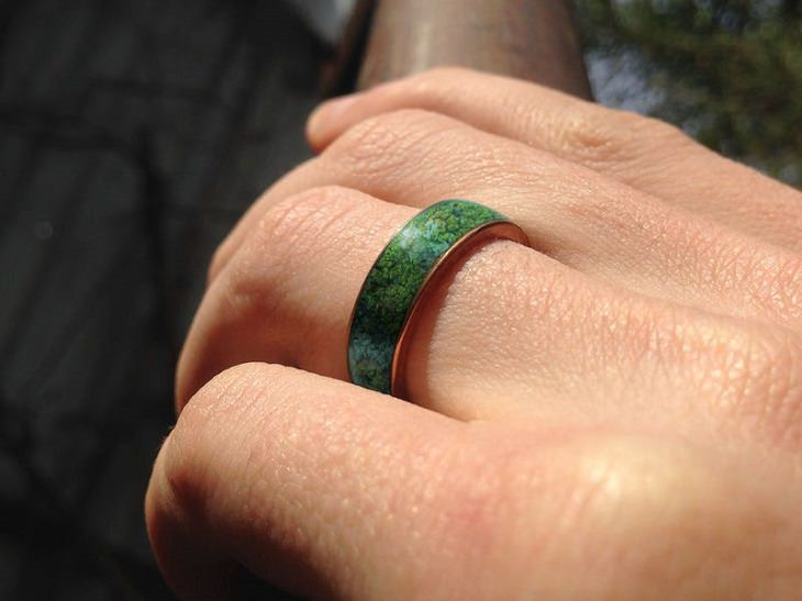 Incredible Scientific Inventions the Future, Microbial Mood Rings green ring on a hand holding a stick