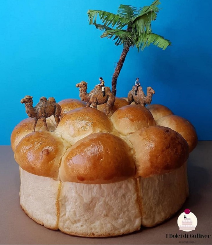 Beautiful Cakes Designed by Italian Chef, Baked cake with large bumps on the top and figurines of men on camels with a palm tree