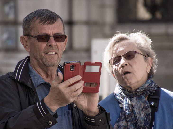 senior citizen with smartphone