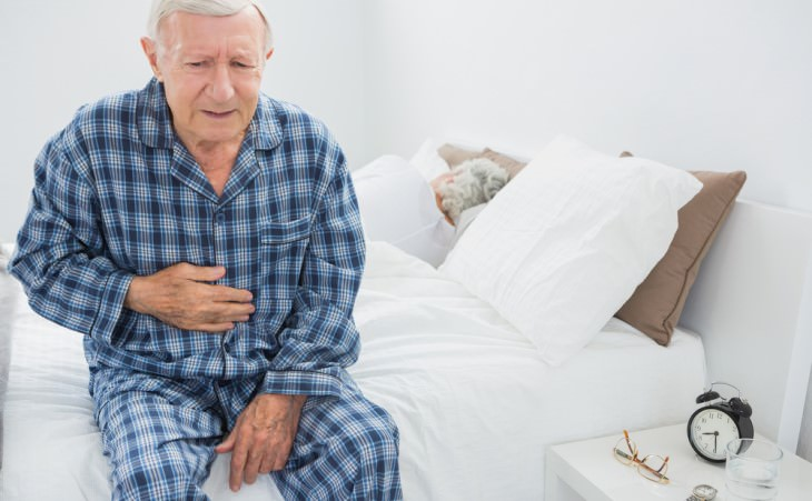 senior man suffering from stomach pain