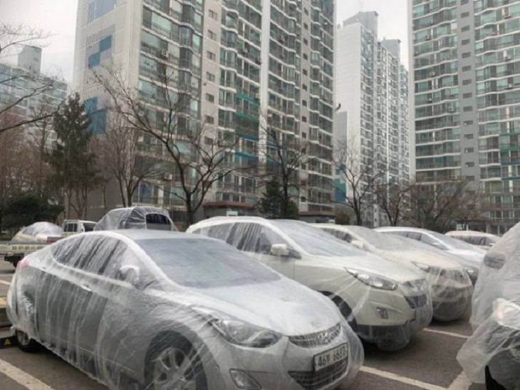 interesting, strange and unique things found only in South Korea, An apartment complex where the cars are wrapped in plastic sheets by the painters when painting is being done to avoid splatter