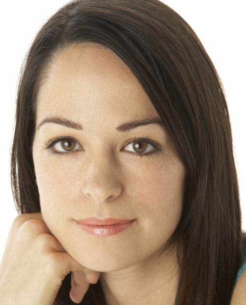 body language mistakes woman smiling thinly
