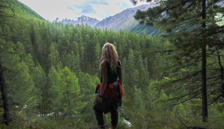 inspirational story woman standing in forest