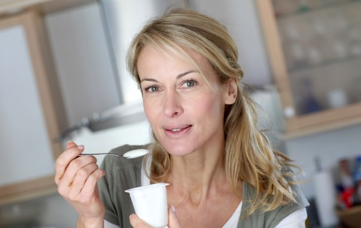 effects of aging on digestion woman holding yogurt