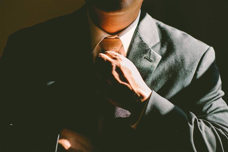 psychological tricks for charisma man in suit