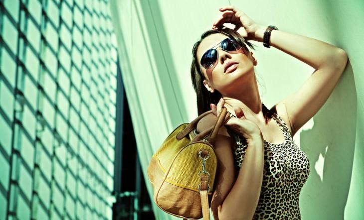 joke woman with expensive bag and glasses