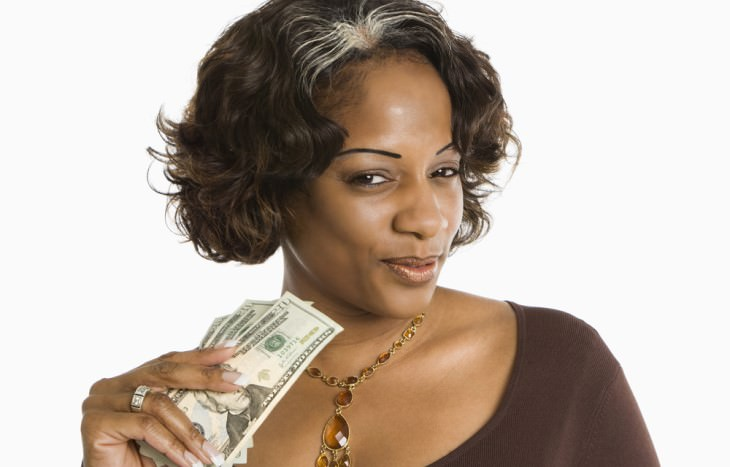 Joke dark skinned woman holding US bills