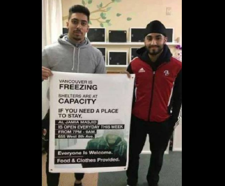 Wholesome and heartwarming pictures and stories, two men holding up a sign inviting people who need shelter to seek refuge in the mosque.