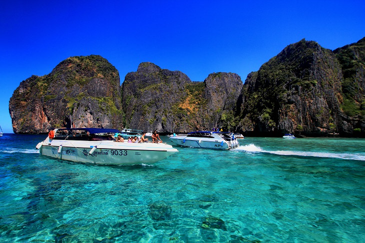 The sights, destinations and fun activities of cultural hub and land of beaches, Krabi in Thailand, speed boats on water