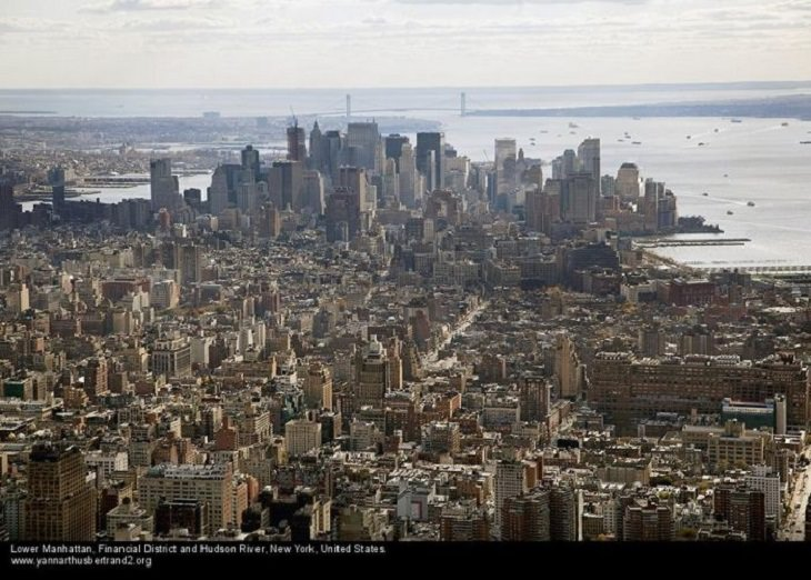 """Aerial photos of New York City in """"New York City From the Air"""" series by Yann Arthus-Bertrand, Lower Manhattan, the Financial District and the Hudson River"""