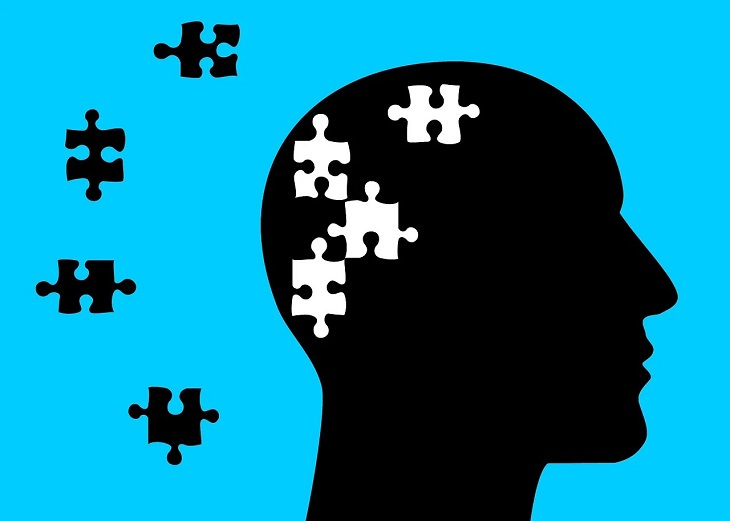 Debunking the myths about mental health, silhouette of head in front of blue background with puzzle pieces removed