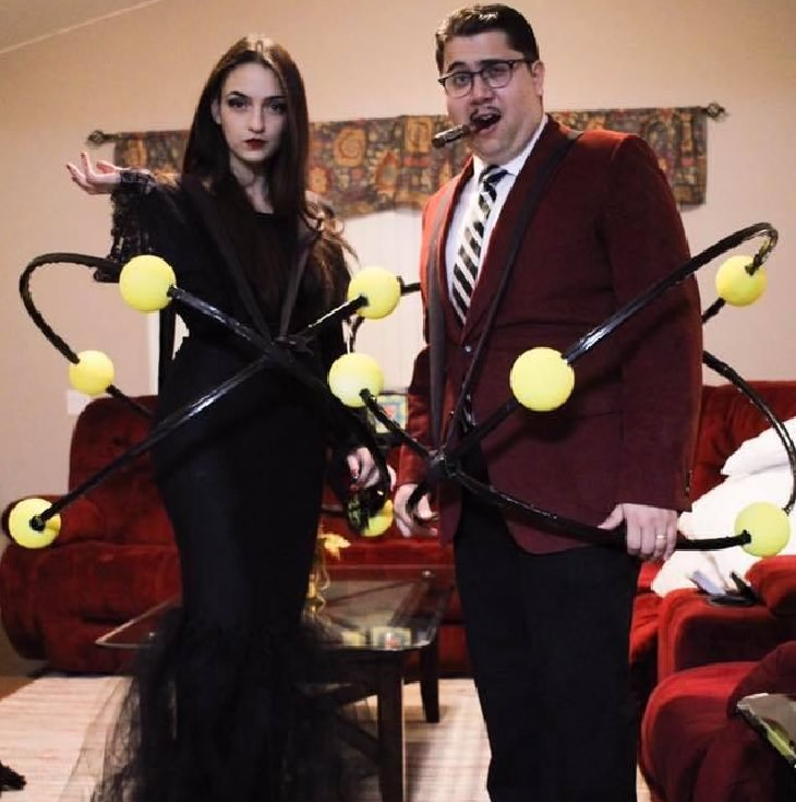 Hilarious and clever Halloween costumes based on puns and word play, The Atoms Family