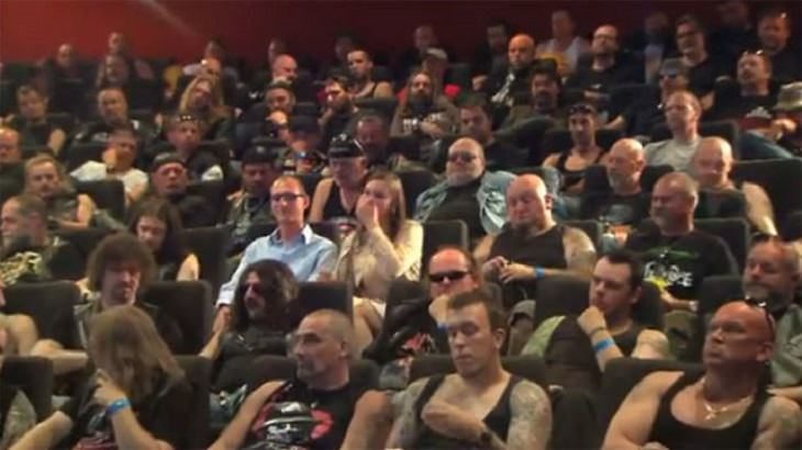 Amazing and insightful social experiments, Couple sitting in a theater surrounded by bikers for Carlsberg social experiment
