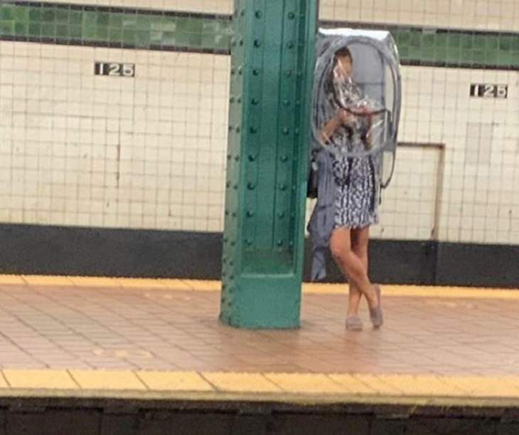 Hilarious photos of strange masks spotted on the subway, Woman in dress wearing laundry bag over her head