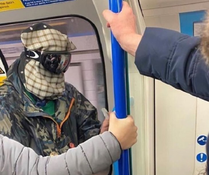 Hilarious photos of strange masks spotted on the subway, Man with a cloth bag over his head and ski masks on