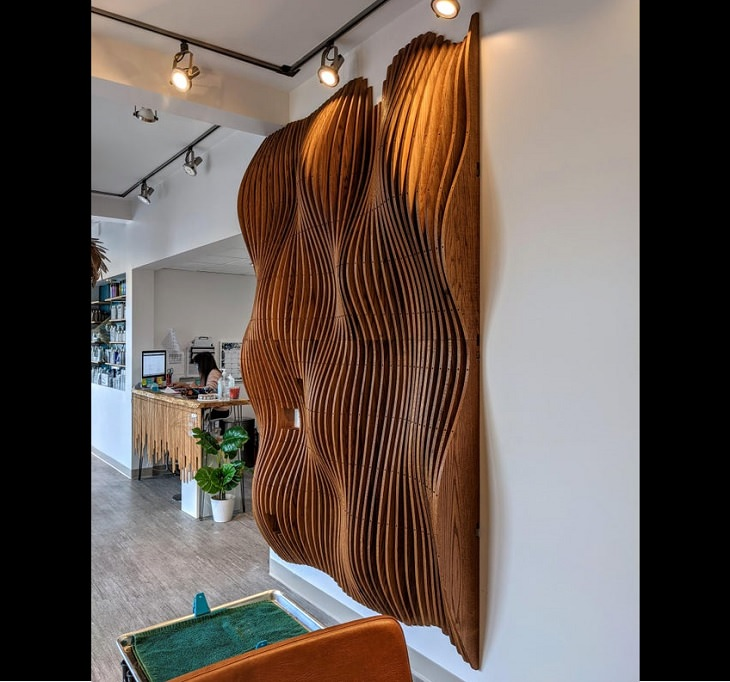 Wood masterpieces made by amateurs and experts, A giant red oak wave wall with cut-outs for outlets and wires