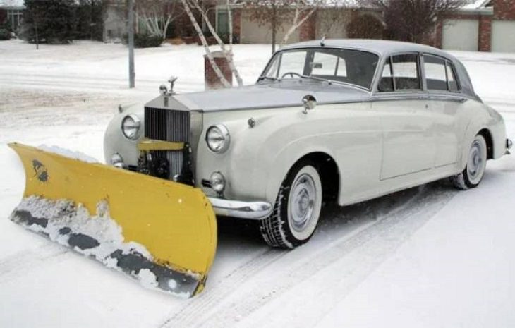 Makeshift, unique, and creative snowplows, silver old limo with snowplow attached
