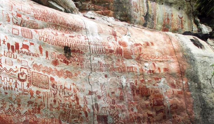 Photographs of cave paintings and rock art on 8 mile cliff in Western Amazon Rainforest called the Sistine Chapel of the Ancients