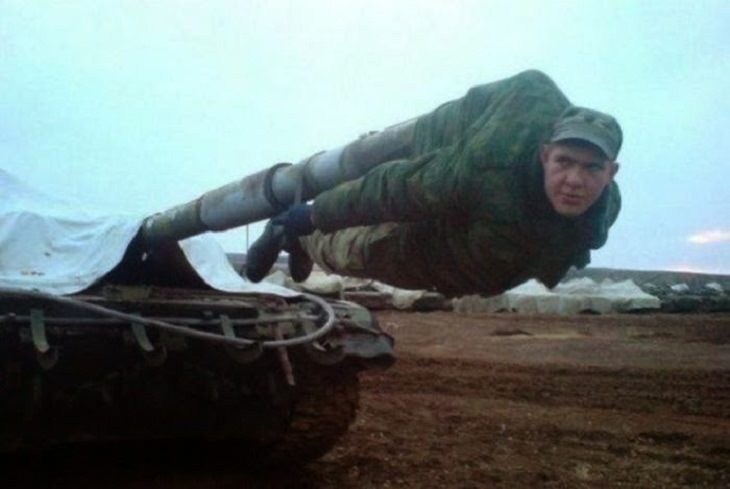 Strange, odd and weird things only found in Russia, man hanging from a cannon tank