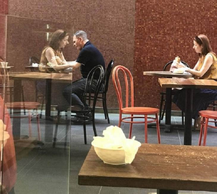 Photographs and pictures of interesting natural phenomenon or well-timed moments that will make you look twice, woman's reflection giving the appearance of her sitting with a man