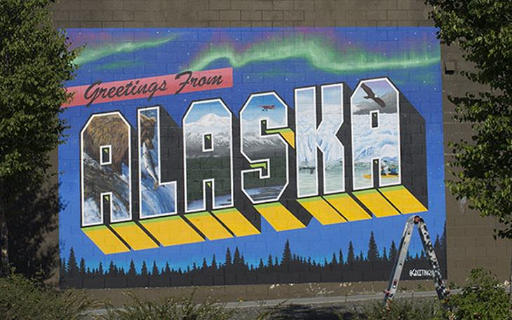 The best and most beautiful street art murals in all states across the United States of America, that send messages of culture, history and community, Alaska, Anchorage, Greetings from Alaska, by Victor Ving and Lisa Beggs