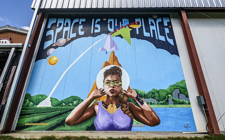 The best and most beautiful street art murals in all states across the United States of America, that send messages of culture, history and community, Alabama, Huntsville, Space is Our Place, by Jahni Moore