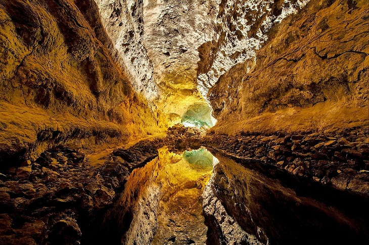Photographs of the best sights and destinations in Lanzarote, one of the most popular islands in Spain's Canary Islands, Cueva de los Verdes, a Cave lake in lava tube that creates an attractive optical illusion