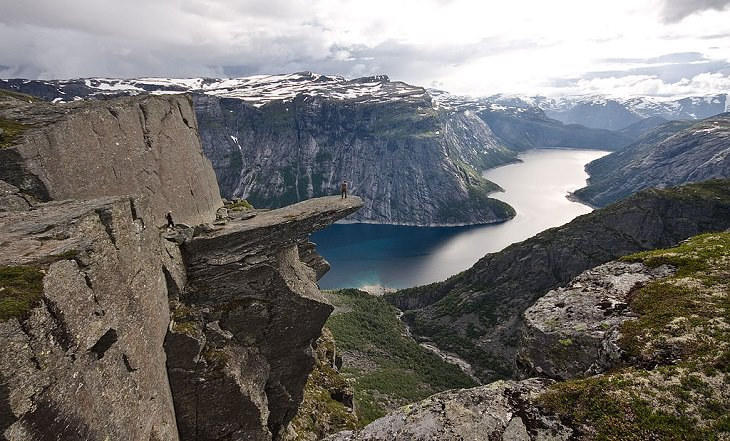 Sights from the popular hiking trail to the rock formation and cliff Trolltunga, near the town of Odda in Norway, A Panoramic view of Trolltunga