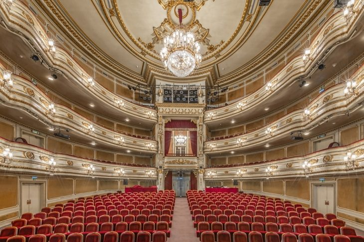 Photographers from travel photographer Richard Silver of the interiors of historic theaters, opera houses and centers for performing arts, taken from the stage, Teatro Nacional D. Maria II, Lisbon, Portugal