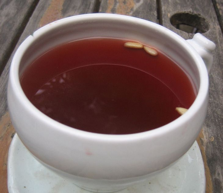 Recipe for healthy Korean traditional cold fruit tea, good for digestion, Sujeonggwa, bowl of tea