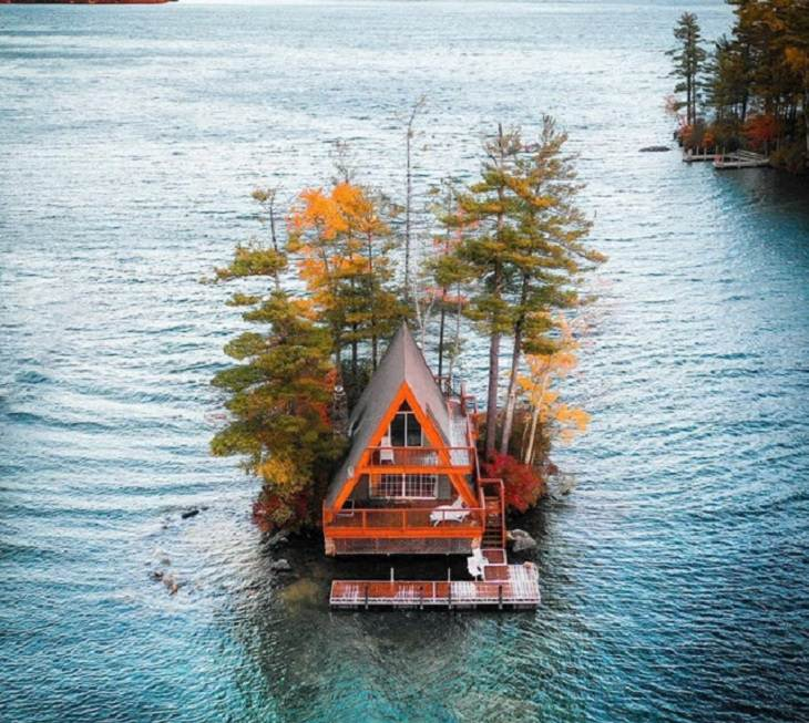 """Beautiful artistic creations made by humankind and civilization over time, """"The A Frame"""" and it's floating dock, on Lake Winnipesaukee, New Hampshire"""
