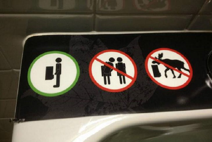 Hilarious pictures that could only be taken in Canada, sign in a bathroom with a symbol to keep out moose